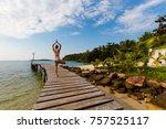 Small photo of Tropical summer yoga session on Klong Mard pier, koh Kood island in Thailand. Vriksha asana, tree pose.