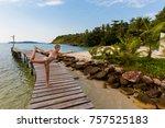 Small photo of Tropical summer yoga session on Klong Mard pier, koh Kood island in Thailand. Warrior pose, Virabhadrasana