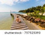 Small photo of Tropical summer yoga session on Klong Mard pier, koh Kood island in Thailand. Namaste, Meditation - lotus pose - padma asana