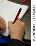 school boy pupil writing notes... | Shutterstock . vector #757543687