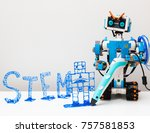 Small photo of November, 2017. Minsk, Belarus. Lego Boost Robot Vernie draws a robot 3d pen with a blue plastic handle. Robotics class for child and teen. Mathematics. Engineering. Technology. STEM education.