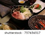Small photo of Japanese hotpot, the Japanese traditional style hotpot with pork belly, vegetable and wild mushroom serve in Japanese set menu. The dinner set for traveler in the hot spring resort in Japan.