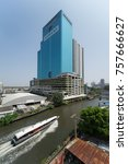 Small photo of BANGKOK, THAILAND - OCTOBER 29, 2017: Chann isara office building 2 with Siemens billboard Advertising and passenger boat in Saen Saep canal.
