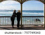 two women leaning on pavilion... | Shutterstock . vector #757749343