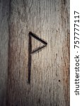 Stock photo the anglo saxon rune wynn which represents the latin letter w carved into wood 757777117