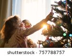 mother and daughter decorate a... | Shutterstock . vector #757788757