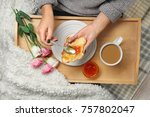 woman spreading jam over... | Shutterstock . vector #757802047