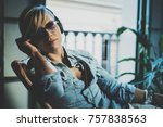 smiling beautiful girl relaxing ... | Shutterstock . vector #757838563