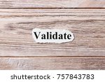 Small photo of VALIDATE of the word on paper. concept. Words of VALIDATE on a wooden background.