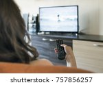 woman hold tv remote control.... | Shutterstock . vector #757856257