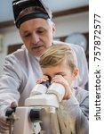 small kid looking through... | Shutterstock . vector #757872577
