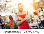 a man is cooking barbecue food. ... | Shutterstock . vector #757924747