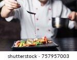 male cook serve delicious steak ... | Shutterstock . vector #757957003