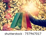 christmas shopping bags in hand ... | Shutterstock . vector #757967017
