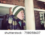boy sticking his tongue on a... | Shutterstock . vector #758058637
