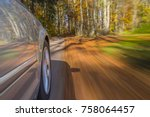 car driving on a street covered ... | Shutterstock . vector #758064457