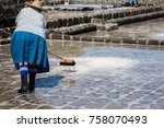 people collect the salt on a... | Shutterstock . vector #758070493