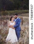 beautiful bride and groom in... | Shutterstock . vector #758089537