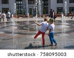 children playing with fountain... | Shutterstock . vector #758095003