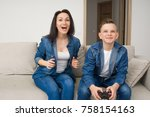 happy mother and son sitting on ... | Shutterstock . vector #758154163
