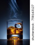 whiskey glass and ice on a... | Shutterstock . vector #758163127