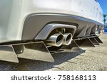 close up of a dual exhaust pipe ...