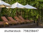 beach loungers and umbrellas on ... | Shutterstock . vector #758258647