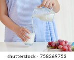 young pregnant woman pouring... | Shutterstock . vector #758269753