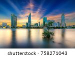 Small photo of Ho Chi Minh City, Vietnam - November 16th, 2017: Riverside City sun rays clouds in the sky at end of day brighter coal sparkling skyscrapers along beautiful river in Ho Chi Minh City, Vietnam