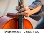 close up of male cellist's hand ... | Shutterstock . vector #758334127