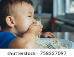 baby in the kitchen eagerly... | Shutterstock . vector #758337097