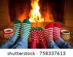 family in christmas socks near... | Shutterstock . vector #758337613