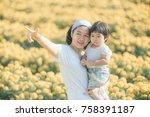 mom finger point teaching to... | Shutterstock . vector #758391187