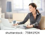 young graphic designer working... | Shutterstock . vector #75841924