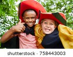 children with costumes holding... | Shutterstock . vector #758443003