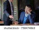stressed asian business man...   Shutterstock . vector #758474863
