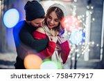 young romantic couple is having ... | Shutterstock . vector #758477917