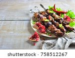 meat shish kebab on a plate... | Shutterstock . vector #758512267