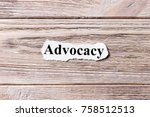 Small photo of advocacy of the word on paper. concept. Words of advocacy on a wooden background.