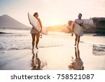 surfers couple running with... | Shutterstock . vector #758521087