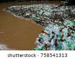 many plastic bottles on shore... | Shutterstock . vector #758541313