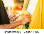 man holding mobile phone and...   Shutterstock . vector #758547403