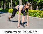 young sportive woman in a... | Shutterstock . vector #758560297
