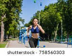 young healthy woman in a bright ... | Shutterstock . vector #758560303