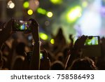 hand with a smartphone records... | Shutterstock . vector #758586493