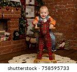 little baby boy on rocking... | Shutterstock . vector #758595733