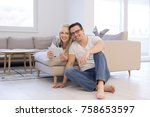 young couple relaxing at  home... | Shutterstock . vector #758653597