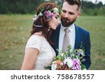 the enamored groom looks at his ... | Shutterstock . vector #758678557