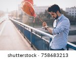 sad man waiting for date on... | Shutterstock . vector #758683213