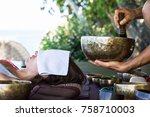 singing tibetan bowls. the man... | Shutterstock . vector #758710003